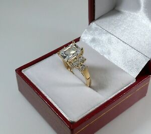 14K YELLOW GOLD RADIANT AND PRINCESS CUT CZ ENGAGEMENT RING