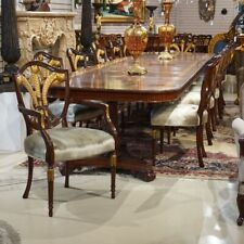 Set of 12 mahogany traditional featherback dining chairs with gold leaf details