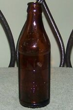 OLD EMBOSSED CERTO FRUIT PECTIN AMBER GLASS BOTTLE WITH UPSIDE DOWN MEASUREMENTS