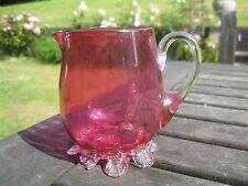 Victorian cranberry glass jug .9cms .Classical shape, frilled bottom . Sweet an