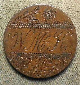Engraved: W Mc K on a 2c piece, filigree around, possibly political -William McK