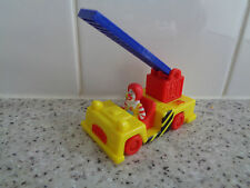 McDonalds Happy Meal Toy Ronald McDonald in yellow and red fire engine truck