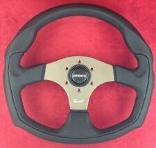 Genuine Momo Tomcat black leather 350mm steering wheel with anthracite spokes.