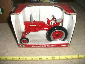 1/16 ERTL Farmall Case iH 230 wide front tractor; nib