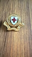 BRITISH RED CROSS GILT AND ENAMELLED HAT BADGE
