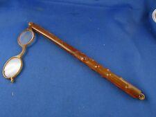 ancienne paire de lunettes main binocle epoque 1900 lorgnons ambre