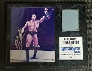 WWE Brock Lesnar Autographed Wrestlemania XIX (2003) plaque w/ piece of ringmat
