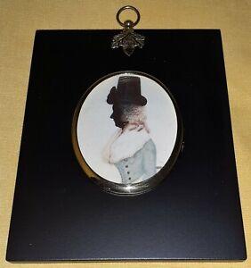 Portrait Miniature of a female silhouette in colour in a black frame