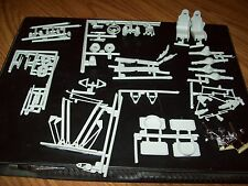 LOT OF SUSPENSION, SEATS, RADIATORS, INTERIOR, ETC. PARTS 1/25 SCALE