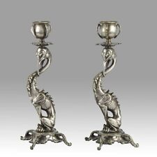 A pair of Antique French Fantasy Silvered Bronze Candlesticks