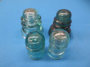 Four Vintage Blue Glass Telephone Pole Insulators