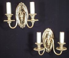 PAIR OF EARLY 20th CENTURY CLASSICAL REGENCY OVAL BACK SILVERPLATE SCONCES