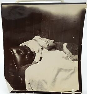 Antique Amateur photo woman lying on the couch 1900.