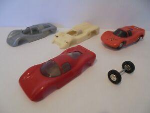 ELDON SLOT CAR AND THREE SPARE BODY SHELLS ETC