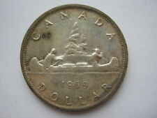 Canadá 1959 dólar de plata GVF desigual Tonificación