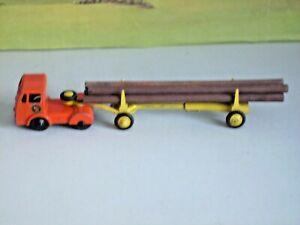 BUDGIE SEDDON DEISEL TRACTOR AND TIMBER TRANSPORTER TRAILER AF