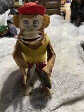 vintage clapping monkey