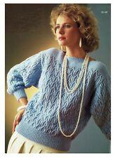 Lady's sweater knitting pattern in DK. jumper, pullover slash neck.