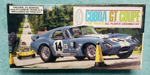 56 year old AURORA Shelby Cobra GT Coupe with figures 100% & unbuilt