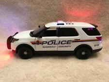 1/24 SCALE DIECAST NASSAU COUNTY POLICE FORD SUV WITH WORKING LIGHTS AND SIREN