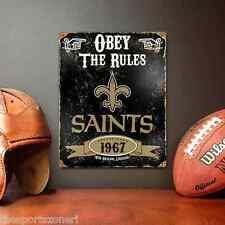 """New Orleans Saints Vintage """" Looking """" Metal Sign"""