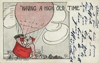 1909 VINTAGE DRUNK in a HOT AIR BALLOON HAVING A HIGH OLD TIME POSTCARD - USED