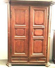 armoire louis XIV à pans coupés en chêne massif deux portes  . XVIII siècle .