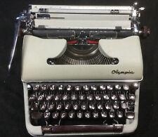 Vintage 1950s OLYMPIA DeLuxe Werke AG Wilhelmshaven TYPEWRITER Portable w/ Case