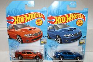 HOT WHEELS '06 PONTIAC GTO ORANGE AND BLUE LOT OF 2
