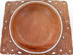 .VERY LARGE OCEANIA TRIBAL HIGHLY CARVED WOODEN BOWL + MOTHER of PEARL INSERTS.