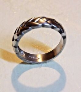 A hand finished Sterling silver ring,weave design, size N full UK hallmark