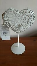 Very pretty white metal tea light holder on stand in the shape of a heart