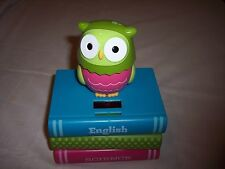 Solar Powered Owl Bank Sitting on Stack of Books