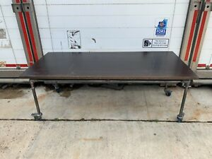 ANDY THORNTON INDUSTRIAL STYLE SCAFFOLD RECTANGULAR TABLE ON ROTATING WHEELS