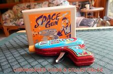 SANKO TOY COMPANY JAPAN TIN LITHO FRICTION SPARKING SPACE GUN NOS MINT CONDITION