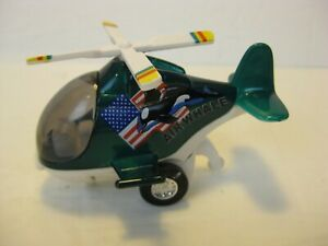 JUNYE Toys Air Whale Helicopter American Mechanical winds up rolls blade spins