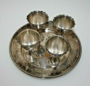 4 alte versilberte ornamentierte Eierbecher und Teller , Größe  Ø 17cm //483