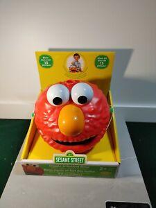 Sesame Street Giggle & Bubble Elmo Automatic Bubble Blower Holds 4 Fl. Oz.