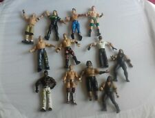 12 x WWE figures from Jakks & Mattel, some dated back to the 90's