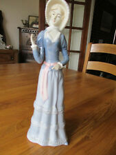 China figurine of lady in a bonnet