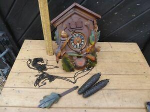 Vintage Cuckoo Clock with Cuckoo and boy - 2 doors at top. with Music box