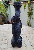 Oiseau chandelier en bois sculpté