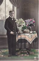 uralte AK, Konfirmation Junger Mann am Tisch mit Blumenstrauß und Kuchen //34