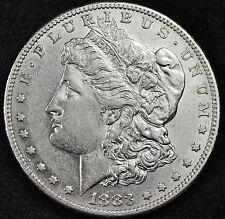 1883-s/s Morgan Silver Dollar.  Double MM. Part  Chest Feather's.  Choice A.U.
