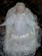 """10"""" Musical Bisque And Clothe Baby Sleeping In Bassinet Head Moves To Lullabye."""