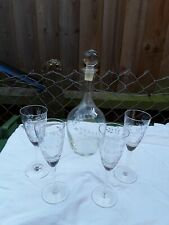 Crystal cut decanter and 4 crystall cut sherry glasses.