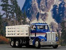 1/64 SPECCAST BLUE/WHITE PETERBILT 385 STAKE BED TRUCK