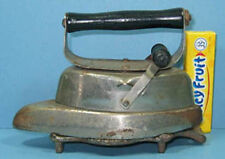 OLD TOY ASBESTOS SLEEVE IRON WITH ORIG TRIVET CI 860