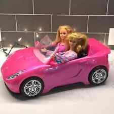 Barbies with barbie car