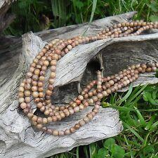 1 fil de 40 perles artisanal en pierre trés légére